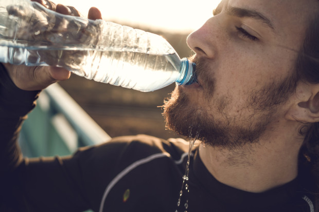 A young man with Sjögren's syndrome drinking a lot of water.