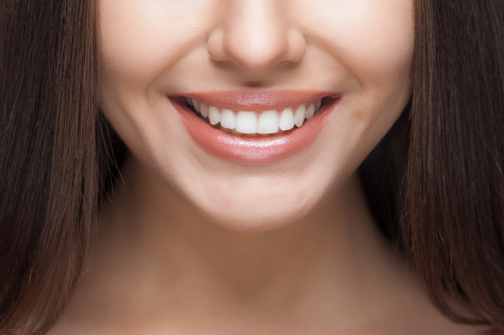 Methamphetamine-related tooth decay can be remedied, as shown by this picture of a woman with white, healthy teeth.