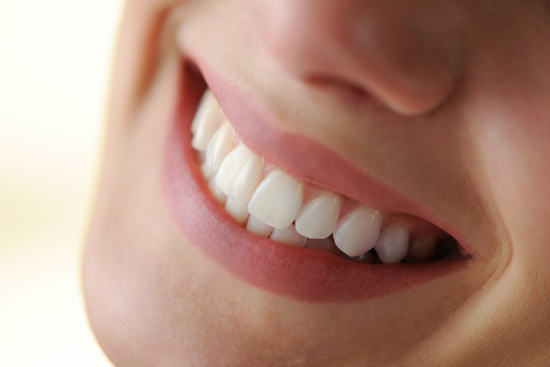A healthy smile resulting from a successful laser pocket disinfection.