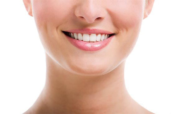 A woman has a healthy smile after her LANAP procedure because she stuck to a strict diet and avoiding certain foods.