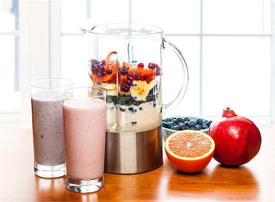 A display of smoothies blenders and fruit are great diet alternatives to full meals in the days before and after your LANAP procedure.